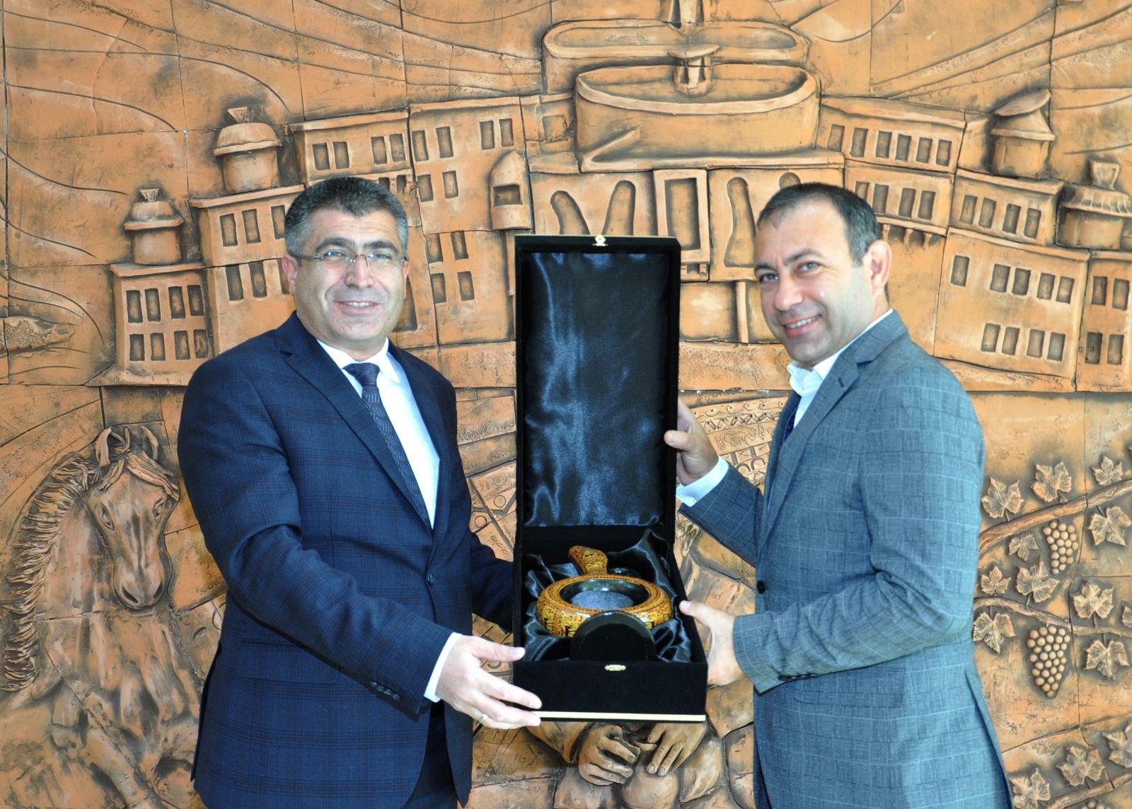 Başkan İbaş'tan NEVÜ Rektörü Aktekin'e Ziyaret.